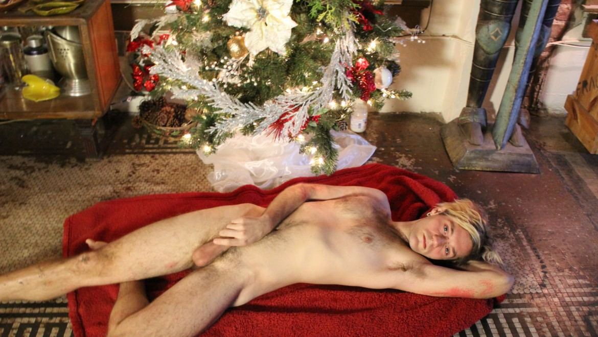 A Christmas Twink Unwraps His Package Under the Tree